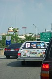 Station wagon with many bumper stickers!