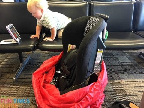 Here you can see how the car seat with luggage cart attached fits nicely inside the Car Seat Gate Check Bag.