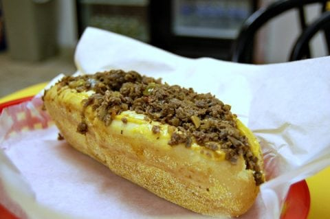 A cheesesteak sandwich on a hoagie roll.