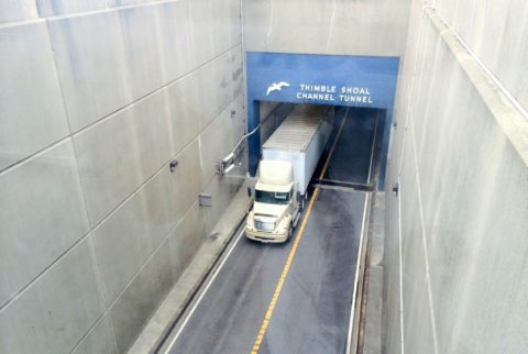 A semi tractor trailer coming out of the tunnel on the Chesapeake Bay Bridge.