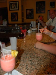 Drink on the left and middle: Coco Rosa. Jim at the end of the bar with his Aruba Ariba drink.