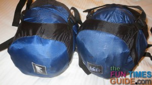 These are the 2 compression stuff sacks we use to permanently hold our rain suits in the saddlebag.