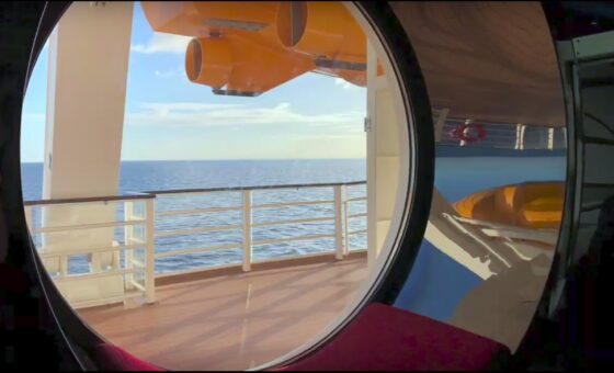 A look out of one of the large porthole windows on the Disney Dream cruise ship.
