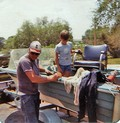 Lynnette's dad and brother Mike preparing the boat for our annual trek to Florida. While Dad used the boat to fish from upon our arrival, we also used it to haul all our luggage, bikes, etc. for a 2-week stay in Florida.