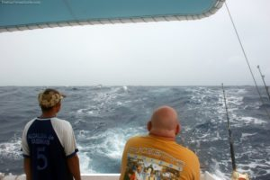 Jim reeling in the huge Wahoo fish he caught deep sea fishing in Aruba.