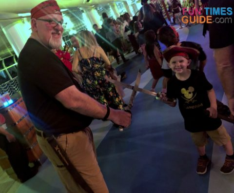 Uncle Jim (aka Funcle) enjoying Pirate Night with Cam on the Disney Cruise ship.