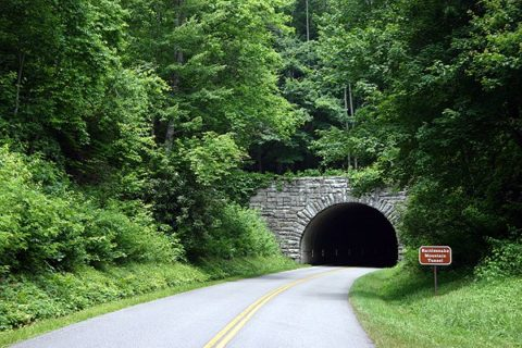 approaching a dark tunnel on a dangerous mountain road