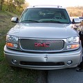 The SUV that rear-ended me during rush hour traffic on the way to work. Here, the driver, a VERY nice gentleman, was writing down his information for me, but we never reported it as an accident, nor turned it in to our insurance companies.