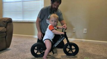 He is a natural... future motorcyclist on board!