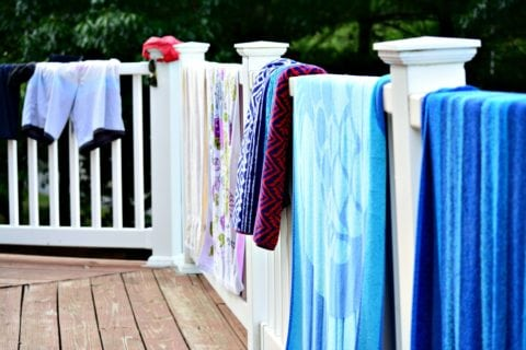 At a hotel, you have to resort to using the balcony railing to air dry swimsuits, towels, and other wet clothes.