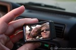Self-portrait of Jim & Lynnette jeeping... in a tiny convex mirror.