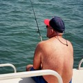 Jim enjoying some fishing from the pontoon boat.
