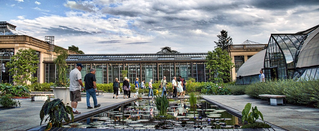 This is the courtyard view of the Conservatory greenhouses at Longwood Gardens - with a Waterlily pond.