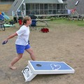 Lynnette trying her hand at the Cornhole game.