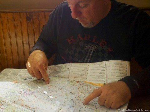 Jim is plotting our course for adventure on our first multi-day motorcycle ride. Here he is pointing to the area I am about to photograph using the CamScanner app. We used the harley davidson apps as well.
