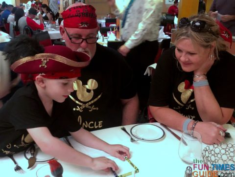 5-year-old Cam trying to repeat the magic tricks we learned at dinner on Disney Dream cruise.