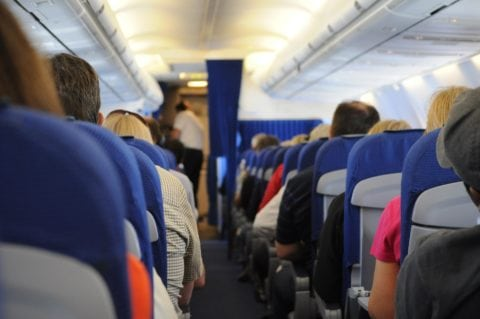 You'll want to remove the luggage cart from the car seat BEFORE reaching your seat -- because the space to work is really tight on a plane.