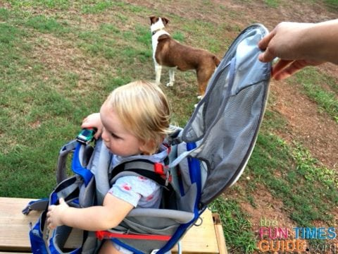 The sun shade on the Osprey baby carrier is integrated right into the pack, and it's collapsible - which means it can be opened or closed quickly!