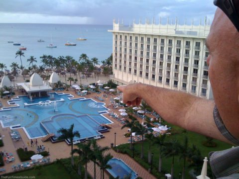 Jim pointing toward the pool at the RIU Palace Hotel and Resort - our favorite place to stay for Aruba all inclusive vacations.