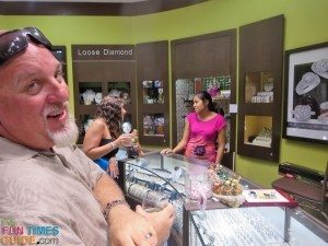Jim enjoying his beverage while I'm trying on rings at Queens Jewelers in Aruba.