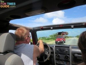 Driving down the road in a Jeep on the second of our Aruba vacations