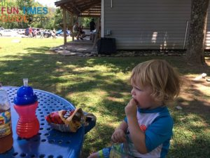 My 2-1/2 year old enjoying a snack after tubing at RIver Rat.