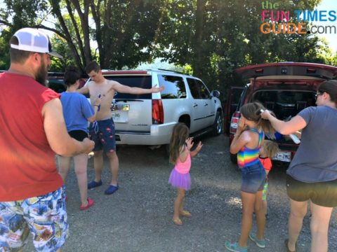Last-minute sunscreen application in the parking lot before river tubing.