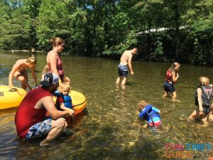 Kids of all ages playing in the shallow water while river tubing with River Rat.