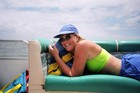 Relaxing and catching some rays on a pontoon boat.
