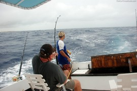 Terry reeling in the huge Wahoo fish he caught on vacation in Aruba