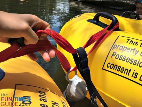 A closeup of our water bottle clipped onto the tether, and dangling in the water to keep it cool.