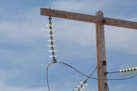 A closeup of what insulators on a utility pole look like