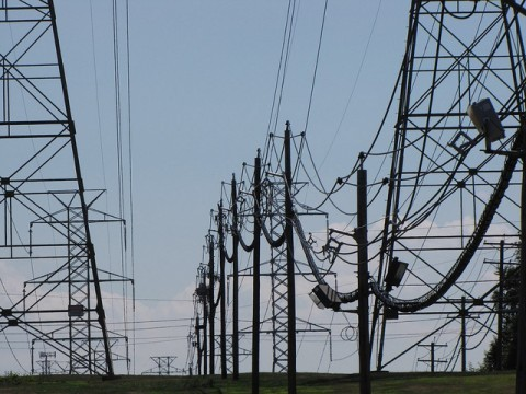 You rarely see one lone electric pole - they're erected in groups.