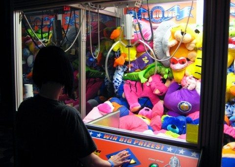It's not as easy as it looks to win at the arcade claw machine